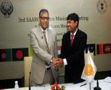 Shri Ravindra Singh, Secretary, Culture, Goverment of India greeting a foreign delegate at the official level meet of the 3rd SAARC Cultural Ministers summit.